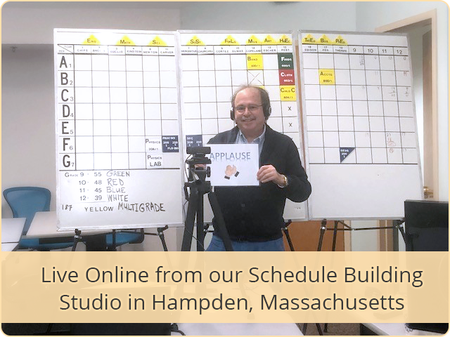 Rich Rediker with Applause Sign at the Master Schedule Building Studio Classroom